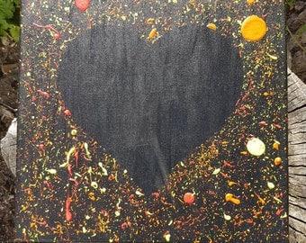 heart using neon paint splatters canvas