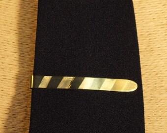 Anodized titanium tie-clip