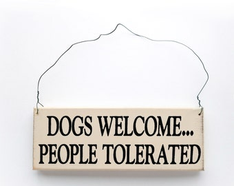 """Wood Sign Saying """"Dogs Welcome, People Tolerated"""" White Wood With Black Lettering"""