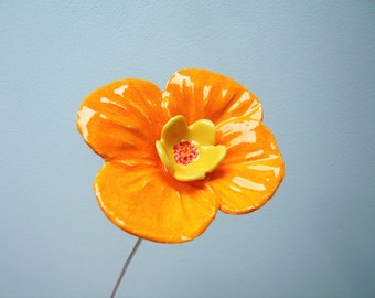 Orange flower ceramic to decorate his house at the yellow heart