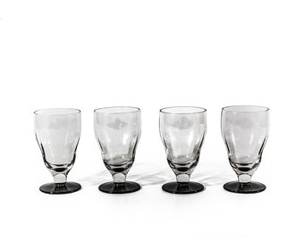 Set of Four Footed Drinking Glasses