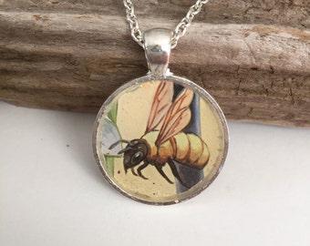 Round honey bee pendant