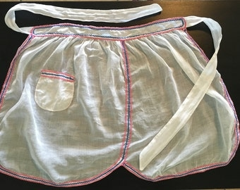 1950's white apron trimmed in pink and blue