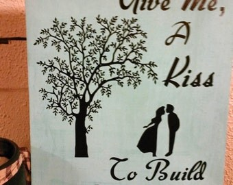 Cute A Kiss To Build A Dream on Wooden Sign