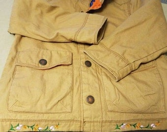 4T girls khaki jacket with orange lining. Embroidered flowers around bottom