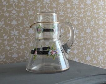 Antique water carafe with matching beaker