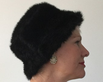 Black faux fur hat bought in Paris in 1990's.