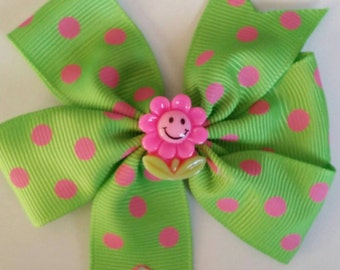 Green polka-dot flower bow by RoselliesClosetshop