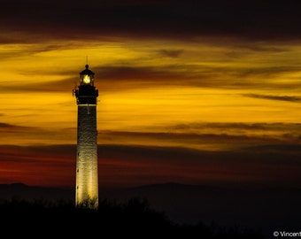Biarritz lighthouse sunset. Color photograph of the Biarritz lighthouse to the sunset. Fine art photography