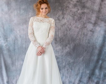Romantic A-line corset wedding dress with lace bodice and long train