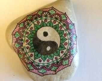 Hand drawn Yin Yang mandala on Lake Michigan tumbled smooth stone