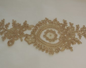 A large Gold floral lace applique with gold cords / lace motif is for sale. sold by per piece