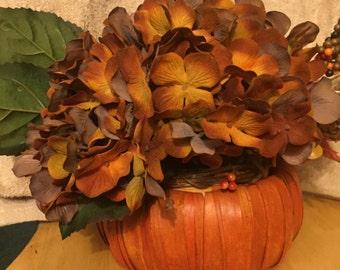 Deep orange in wicker pumpkin. #341