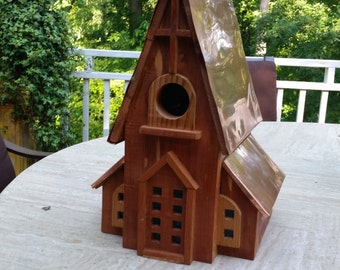 Handcrafted cedar and copper bird houses