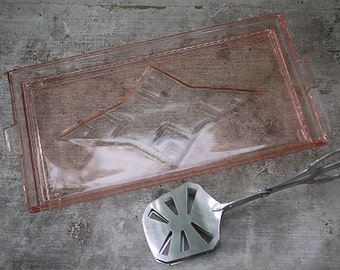 Antique Pink depression cake plate and Cake tong 1930's. Old pink depression glass cake dish and his claw to cakes