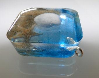 handmade pendant with real starfish, seashell and sand from the island of Borkum