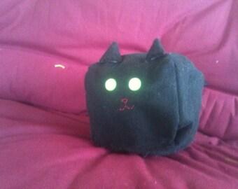 Adorable cubed black cat!
