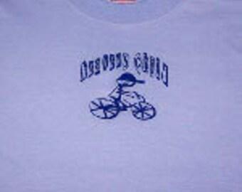 Heavens Child tshirt boy riding his bike