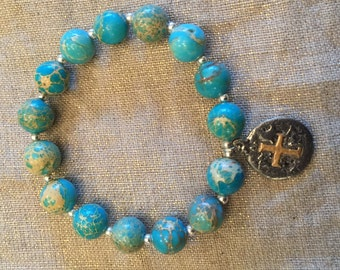 Turquoise and Silver Stretch Bracelet With Charm