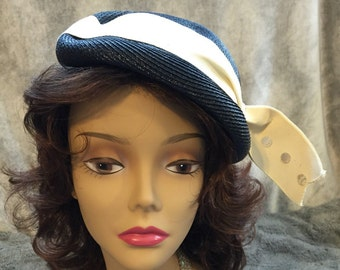 High fashion deep blue vintage straw hat with white bow accent