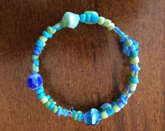 Memory Wire Bead Bracelet.  Blue and Green.  Homade.  One Dollar of Each Purchase Helps a Homeless Animal.