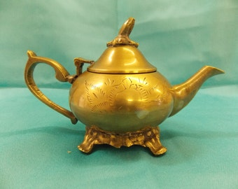 sewing kit in a brass miniature teapot