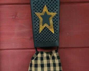 Primitive Cheese Grater Towel holder with Pip Berry and Rusty Star Arrangement