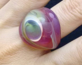 ring glass toasting amber green waves