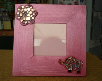 Wooden frame with mosaic decorations
