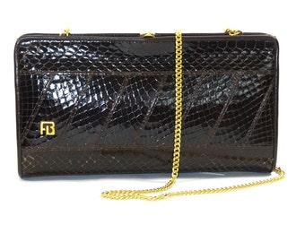 Dark brown clutch bag in real Snake (PeVU/0150-tm-Et)