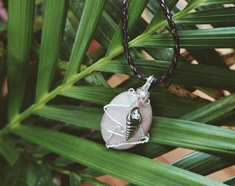 Silver wire wrapped beach pebble necklace.