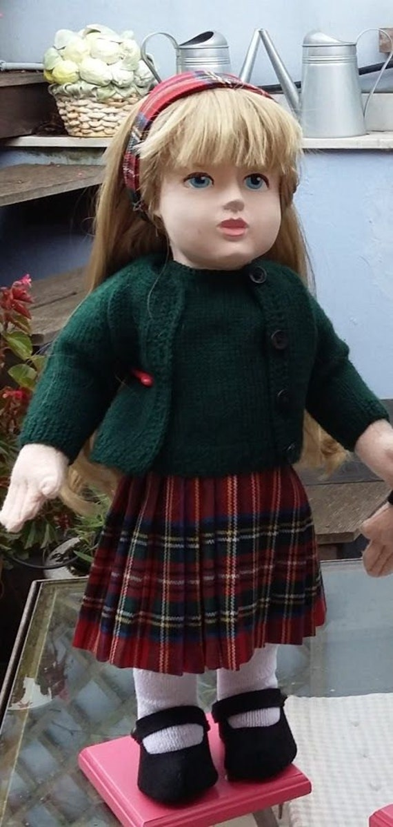 Outfit with tartan skirt and green twin set