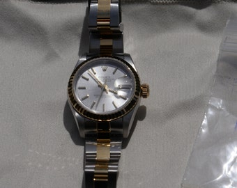 Like new ladies reconditioned Rolex datejust.