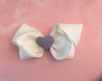 Big glittery hearts on large bows