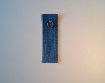 Bookmark made of recycled material and recycled button