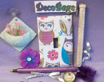 Bling glitters Deco Bag of the month subscriptions include sparkled items: pens magnets window decor switch plate covers earrings pins
