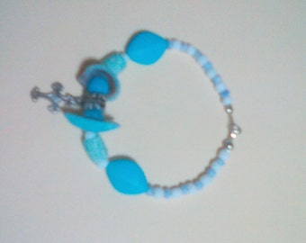 Nautical bracelet with cross charm.