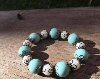 Turquoise and cream beaded bracelet