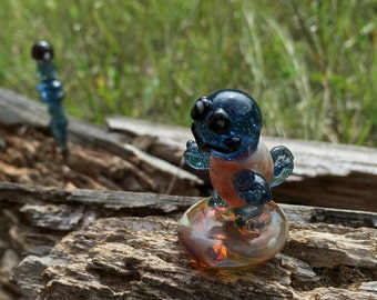 Squirtle figurine and perfume dabber.