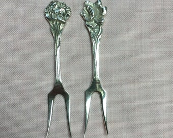 Cocktail forks, picks, 2 pieces, nice flower ornament hallmarked Dutch silver