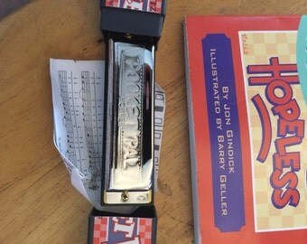 Harmonica and instruction book
