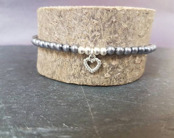 Ladies charm bracelet made with 4mm grey glass pearl beads, silver plated beads & heart charm
