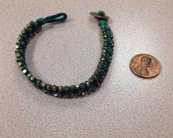 Glod green beaded bracelet button closure