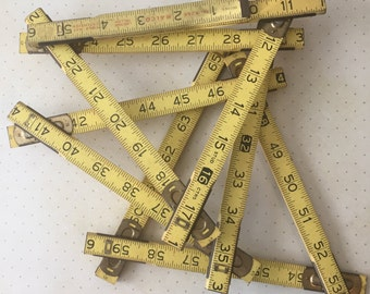 Vintage Malco Four Way Extension Ruler