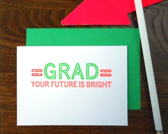 letterpress graduation neon sign greeting card fluorescent green & orange ink on bright white paper grad your future is bright