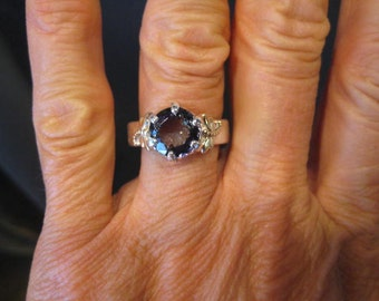 Beautiful Natural Tanzanite Ring ...Nice LARGE Stone ... Sterling Silver and 14 kt Yellow Gold ...  Size  7.5 ......  e894