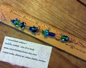 handcrafted copper candle snuffer with green and blue glass beads