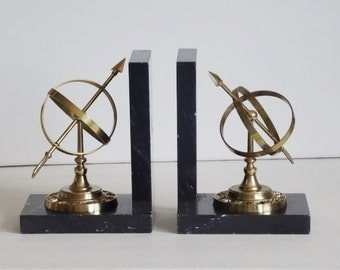 Brass Armillary Sphere Bookends on Black Marble