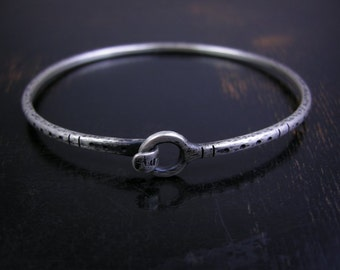 Made to order oval sterling silver hook latch bangle, hand formed metal with hammered rustic finish dots and stripes