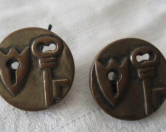 Set of 2 VINTAGE Lock & Key Pierced Plastic BUTTONS